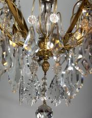 Antique gilded French chandelier with candles and lights