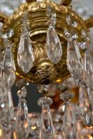 Vergulde lustre a tige Portieux